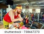 a fat man on a bike simulator... | Shutterstock . vector #738667273
