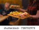 woman holds trays with... | Shutterstock . vector #738702973