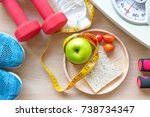 green apple and weight scale... | Shutterstock . vector #738734347