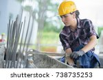 woman working on metal structure | Shutterstock . vector #738735253