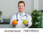 Dietician Holding Fruits