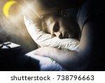 a man sleeps under the moon and ... | Shutterstock . vector #738796663