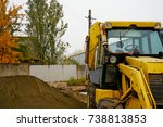 Small photo of The concept of agronomy, a yellow tractor with a bucket demonstrates work