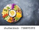 hummus platter with assorted... | Shutterstock . vector #738895393