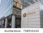 Small photo of WASHINGTON, DC - OCT. 20, 2017: FEMA sign, Headquarters Building. Federal Emergency Management Agency sign with Department of Homeland Security logo, which FEMA has been a part of since 2003