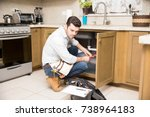 young man working as a plumber... | Shutterstock . vector #738964183