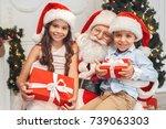 santa claus with kids indoors... | Shutterstock . vector #739063303