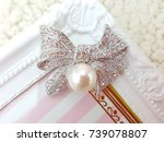 Silver Bow With Pearl Brooch...