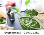 spoon with basil pesto sauce... | Shutterstock . vector #739136257