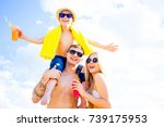 family on a beach | Shutterstock . vector #739175953
