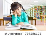 asian kid enjoy reading in the... | Shutterstock . vector #739256173
