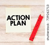 Small photo of action plan / Note with action plan inscription on the wooden background