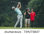 Small photo of KUALA LUMPUR, MALAYSIA - OCTOBER 13, 2017. Golfer, Xander Schauffele from United States in action during the 2017 CIMB Classic golf tournament at TPC Kuala Lumpur in Bukit Kiara.