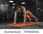 woman exercising in the gym ... | Shutterstock . vector #739303543
