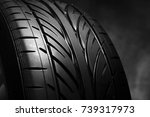 car tires on a dark background. ... | Shutterstock . vector #739317973
