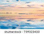 beautiful sunset and mirror... | Shutterstock . vector #739323433