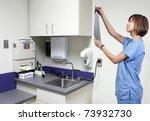 a beautiful female radiologist... | Shutterstock . vector #73932730