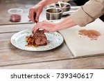 chef putting beef meat on plate.... | Shutterstock . vector #739340617