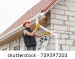 construction worker installs... | Shutterstock . vector #739397203