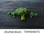 broccoli. on a wooden... | Shutterstock . vector #739404073