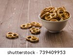 Small photo of abundance of pretzels on a wooden background/abundance of pretzels/abundance of pretzels on a wooden background