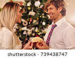 people sharing christmas wafer... | Shutterstock . vector #739438747