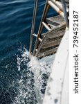 Small photo of metal gangway boat in sea water in sunny day