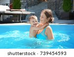 cute little boy with mother in... | Shutterstock . vector #739454593