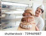 baker woman presenting bread on ... | Shutterstock . vector #739469887