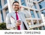 handsome businessman in suit... | Shutterstock . vector #739515943