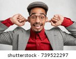 funny mixed race man wears cap... | Shutterstock . vector #739522297
