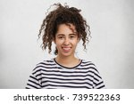 glad pretty woman with curly... | Shutterstock . vector #739522363