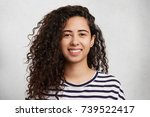 headshot of curly mixed race...   Shutterstock . vector #739522417