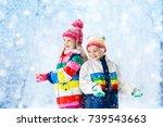 kids playing in snow. children... | Shutterstock . vector #739543663