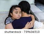 the sad asian girl child hugs... | Shutterstock . vector #739636513