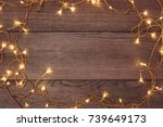 a frame of christmas garlands... | Shutterstock . vector #739649173