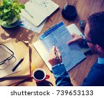 businessman is filling... | Shutterstock . vector #739653133