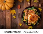 roasted turkey garnished with... | Shutterstock . vector #739660627