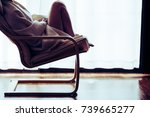 lonely woman sitting in a chair ... | Shutterstock . vector #739665277