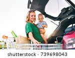 mother with baby boy putting... | Shutterstock . vector #739698043