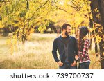 couple in love in autumn leaves | Shutterstock . vector #739700737