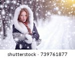beautiful girl in winter forest.... | Shutterstock . vector #739761877
