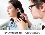 doctor holding otoscope and...   Shutterstock . vector #739798693