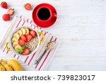 breakfast oatmeal porridge with ... | Shutterstock . vector #739823017