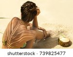 Woman With Coconut Drink Under...