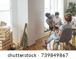 happy caucasian family moving... | Shutterstock . vector #739849867