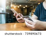 woman hand using smartphone for ... | Shutterstock . vector #739890673