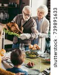 grandfather putting turkey on... | Shutterstock . vector #739891633
