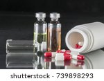 some vials and boat of capsules ... | Shutterstock . vector #739898293