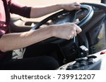 cropped shot of bus driver... | Shutterstock . vector #739912207